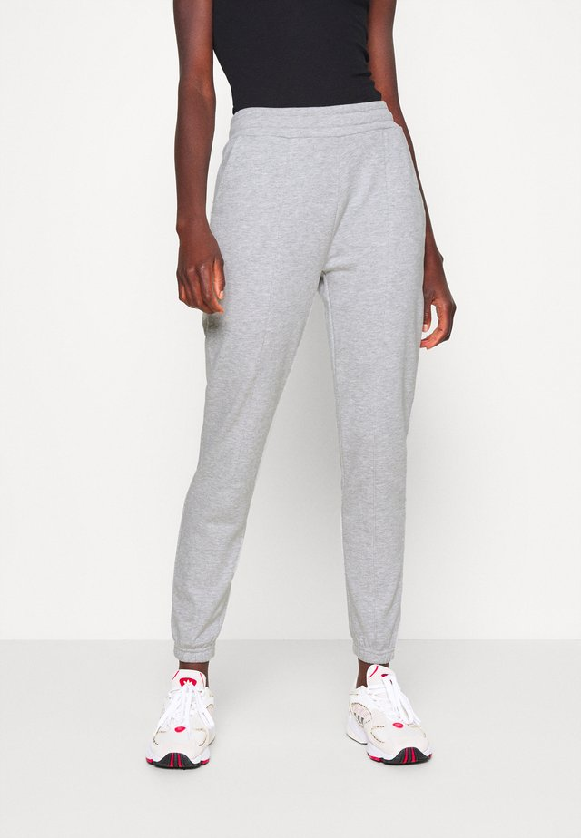 REGULAR FIT JOGGERS - Tracksuit bottoms - mottled light grey