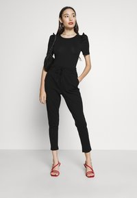 ONLY Petite - ONLPOPTRASH EASY COLOUR PANT - Trousers - black - 1