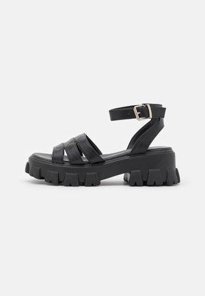 HARMONIE - Korkeakorkoiset sandaalit - black