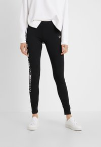 EA7 Emporio Armani - Leggings - Trousers - black/white - 0