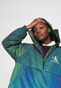 Calvin Klein Jeans - REFLECTIVE POPOVER - Windbreaker - multi coloured - 3