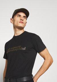 AUTOMOBILI LAMBORGHINI - T-shirt con stampa - nero - 4