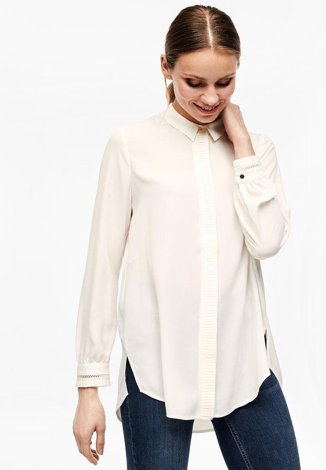 ANIMÉ DE PLISSÉS - Button-down blouse - cream
