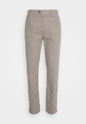 TRAVELER - Trousers - stone