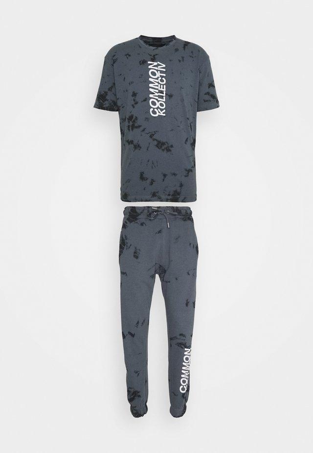 ESSENSTIALS TIE DYE TRACKSUIT UNISEX - T-shirt con stampa - black