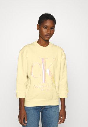 IRIDESCENT MONOGRAM - Sweatshirt - light yellow