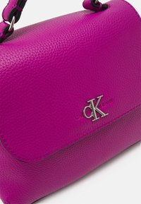 Calvin Klein Jeans - MINI TOP HANDLE - Kabelka - purple