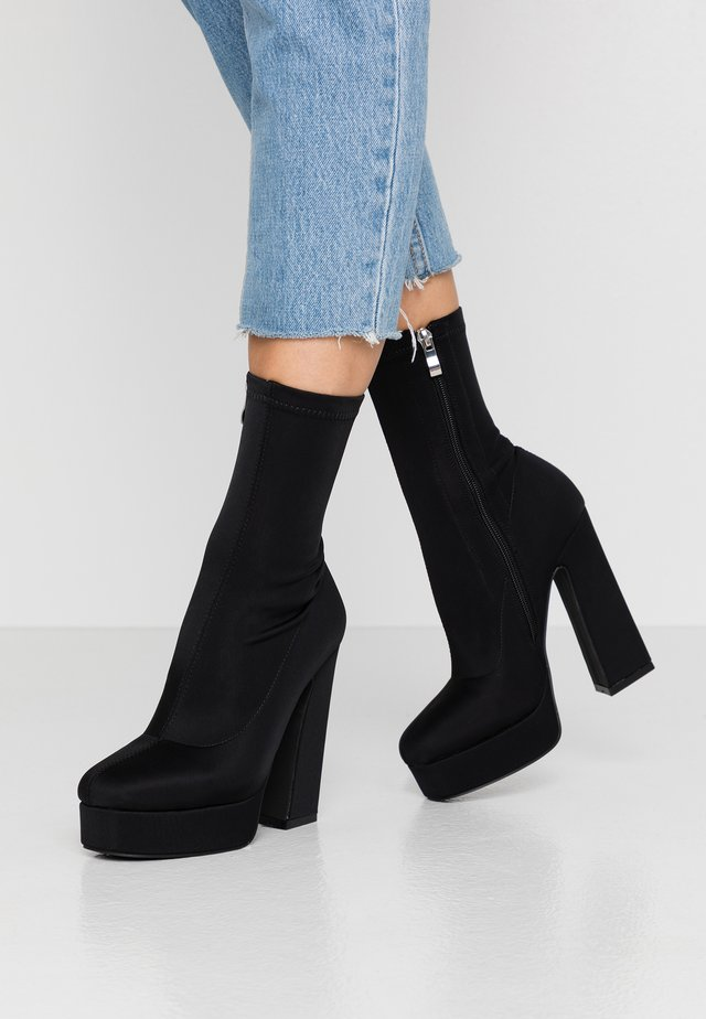 CLANCY - High heeled ankle boots - black
