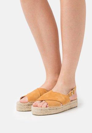 CROSSED FLAT - Platform sandals - brown