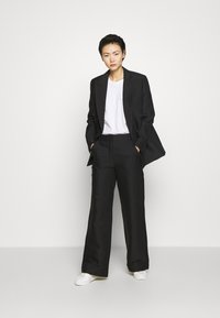 DESIGNERS REMIX - HAILEY FLARE - Trousers - black - 1