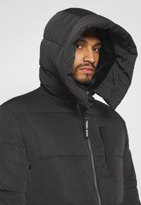 Tommy Jeans - CASUAL PUFFER - Winter coat - black - 4