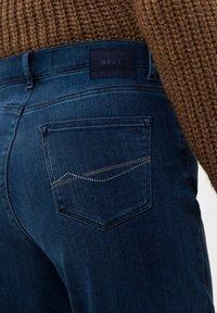 BRAX - STYLE CAROLA - Straight leg jeans - used regular blue - 4