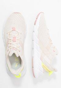 Puma - WEAVE XT SHIFT - Sports shoes - pastel parchment/white - 1