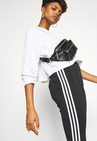 adidas Originals - PANTS - Trainingsbroek - black/white