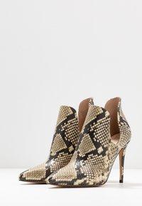 ALDO - AMILMATHIEN - High heeled ankle boots - natural - 4