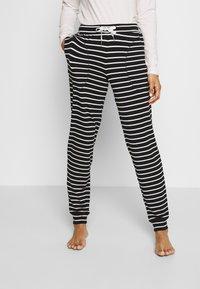 Marks & Spencer London - FLEXI STRIPE PANT REGULAR - Pyžamový spodní díl - black/white - 2