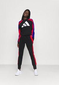 adidas Performance - BIG LOGO - Tuta - black/vivid red/bold blue - 1