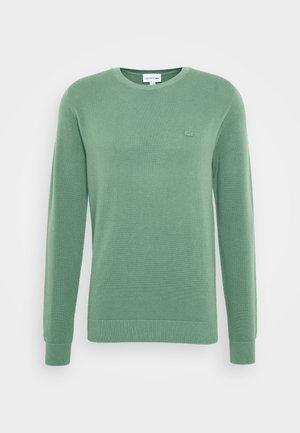 Stickad tröja - grassy