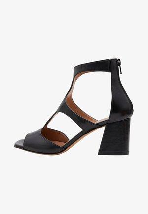 SONIA - Ankle cuff sandals - black