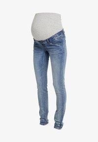MAMALICIOUS - MLGOLDEN - Slim fit jeans - light blue denim - 4