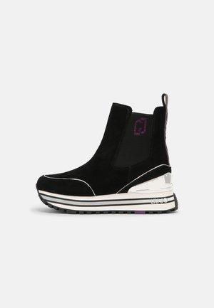 MAXI - Kotníkové boty na platformě - black