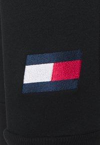 Tommy Hilfiger - CUFFED FLAG LOGO - Tracksuit bottoms - black - 3