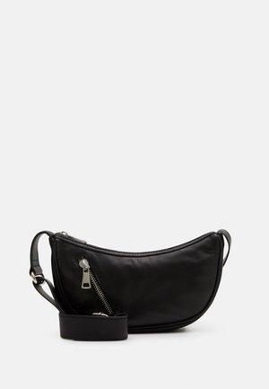SOFTY MINI MOON BAG - Taška spříčným popruhem - black