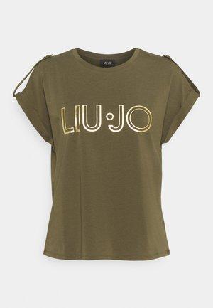 T-shirts med print - feuille verte