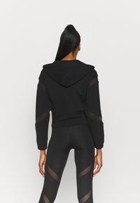 Puma - PAMELA REIF X PUMA FULL ZIP HOODIE - Zip-up hoodie - black - 2
