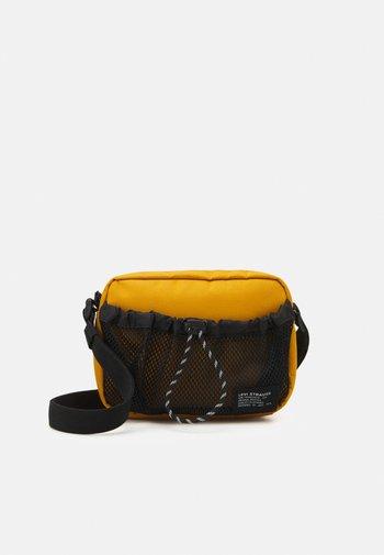 UTILITY CROSSBODY UNISEX - Bum bag - regular yellow