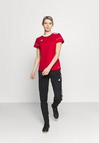 adidas Performance - TIRO - Tracksuit bottoms - black/white - 1
