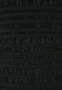 Hervé Léger - PUCKERED STITCH RUFFLE MINI DRESS - Cocktail dress / Party dress - black - 6