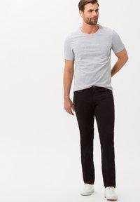 BRAX - STYLE CADIZ - Jeans slim fit - black - 1