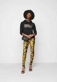 Versace Jeans Couture - LADY FUSEAUX - Leggings - Trousers - black - 1