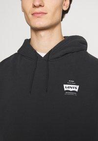 Levi's® - GRAPHIC HOODIE UNISEX - Felpa con cappuccio - jet black - 3