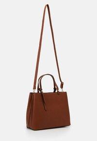 Tamaris - BROOKE - Handbag - cognac - 1