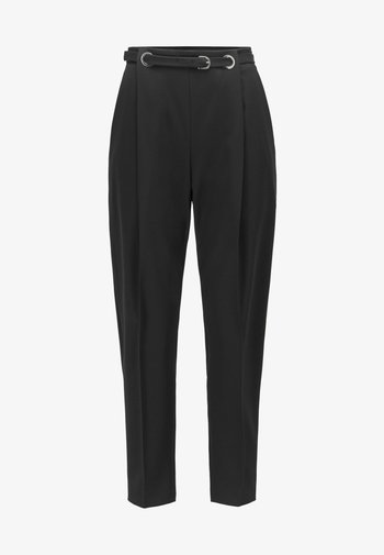 TAWAKEA - Trousers - black
