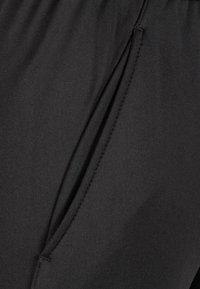 Umbro - Tracksuit bottoms - black - 2