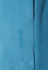 Curare Yogawear - LONG PANTS - Trainingsbroek - light blue - 7
