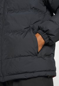 Helly Hansen - REVERSIBLE PUFFER JACKET - Winter jacket - navy - 6