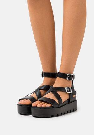 VEGAN CERES GLADIATOR  - Platform sandals - black