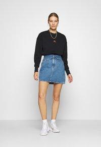 Calvin Klein Jeans - BADGE INTERLOCK - Long sleeved top - black - 1