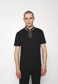 HUGO - DOLMAR - Polo shirt - black - 0