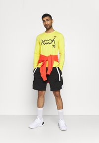 Puma - Long sleeved top - yellow - 1