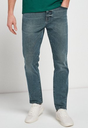 WITH STRETCH - Straight leg jeans - mottled light blue