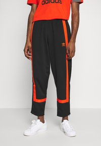 adidas Originals - WARMUP - Tracksuit bottoms - black/corang - 0