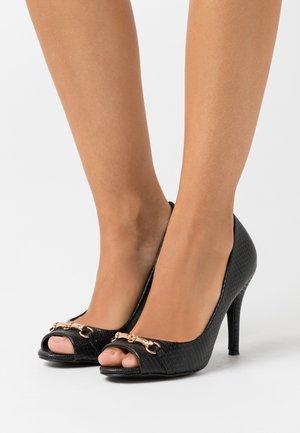CRAVE - Peeptoe heels - black