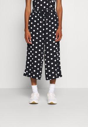 Pantalones - black dot all over