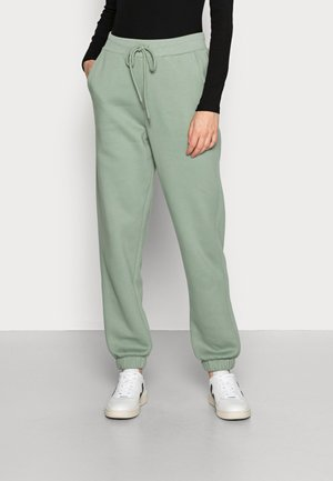 TROUSERS PERNILLE - Tracksuit bottoms - light dusty green