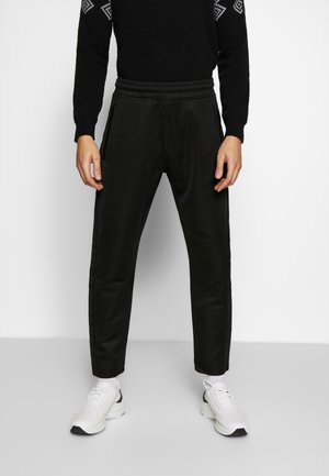 LUX PANTS - Tracksuit bottoms - black
